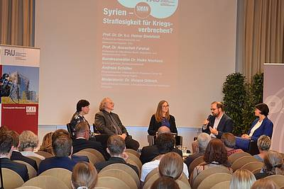 "Dr. Heike Neuhaus, Prof. Heiner Bielefeldt, Dr. Viviane Dittrich, Andreas Schüller, and Prof. Anuscheh Farahat (from left to right) discussing on ""Syria - Impunity for War Crimes?"""