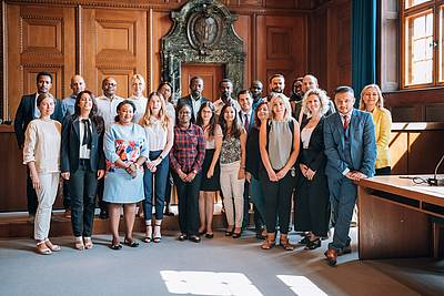The participants of the Nuremberg Summer Academy 2018 at the historic Courtroom 600
